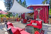 Image of outdoor patio area with red soft seating