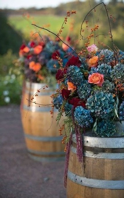 Image of flower bouquets on wine barrels in the fall